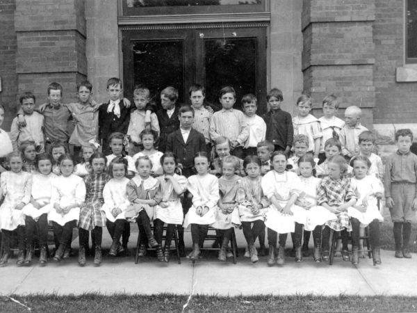 First Grade teacher and her class in Carthage