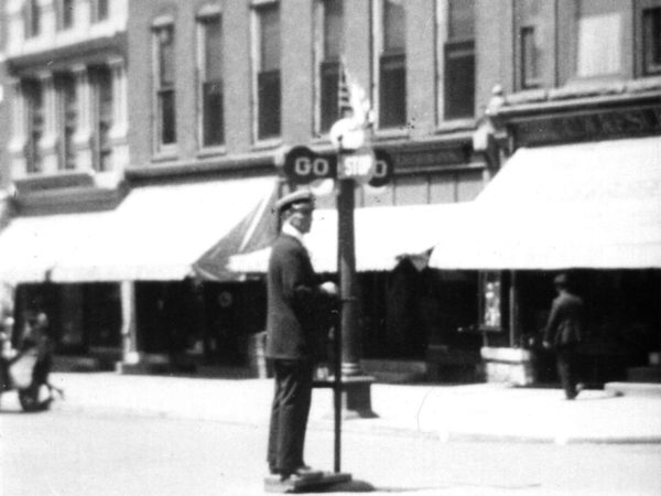 Policeman hand operating a traffic sign in Carthage