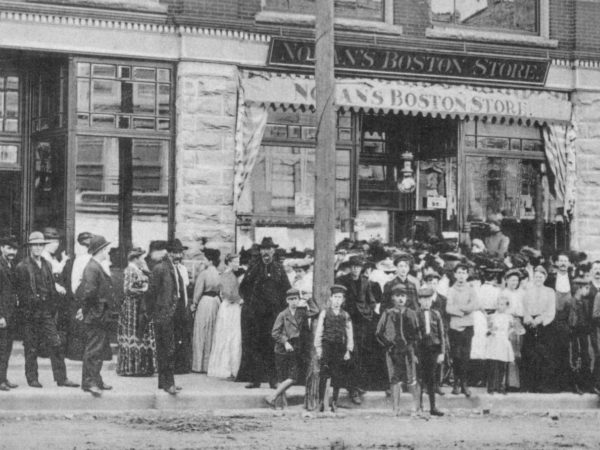 A crowd in front of Nolan's Boston Store in Carthage