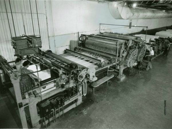 Cutting paper inside the Newton Falls Paper Mill in Newton Falls
