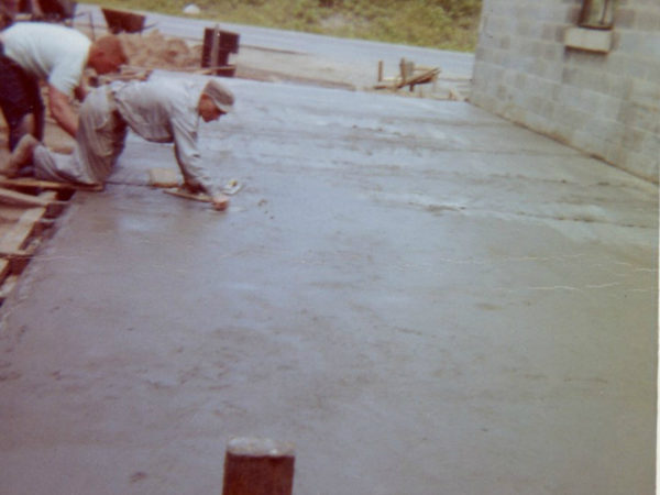Smoothing the foundation of the Cranberry Lake Fire Hall in Cranberry Lake
