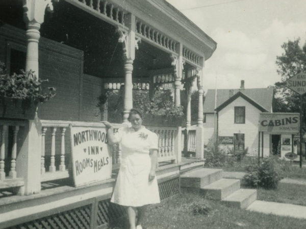 Sue Snyder in front of the NorthWood Inn in Cranberry Lake
