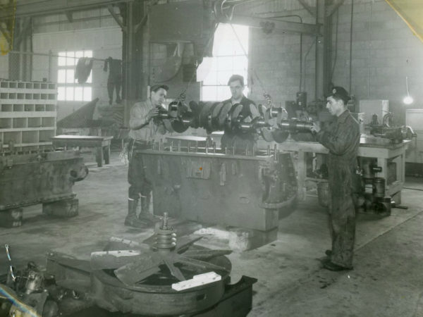 Inspecting a crank shaft in the garage of the Jones & Laughlin Steel Corporation in Benson Mines