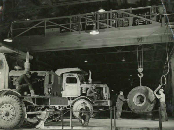 Mechanics working on trucks inside the garage of the Jones & Laughlin Steel Corporation in Benson Mines