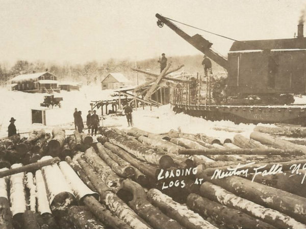 Loading logs in front of the railroad depot in Newton Falls