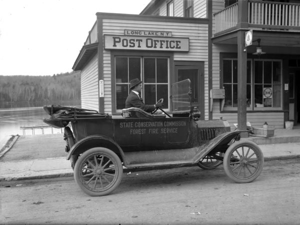 Pat Cunningham driving a NY State Conservation Department Ford Model T in Long Lake