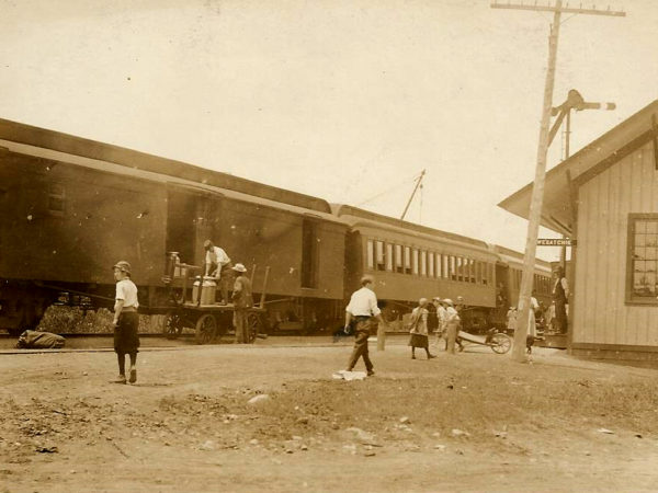 Loading milk cans at the train station in Oswegatchie