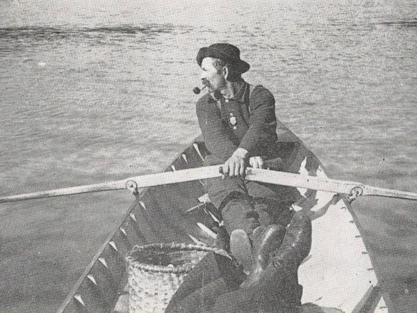 Bill Rasbeck at the oars of an Adirondack Skiff