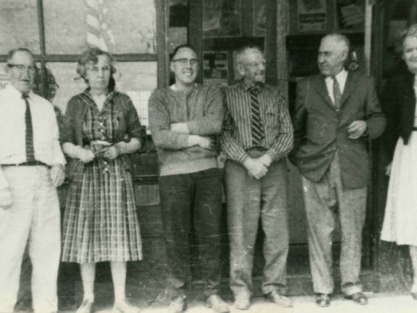 Lisbon Post Office employees pose in front of the post office. Pictured left to right: Art Harper, Doris Putney, Tom Driscoll, Ralph Scott, Earl Jones (Post Master), and Buleah Kelly. Earl Jones was Post Master from October 31, 1955 to July 16, 1958. Photo circa late 1950s (55-58). Lisbon, NY. Original photo loaned by current Post Master Michael Legacy on August 1997.