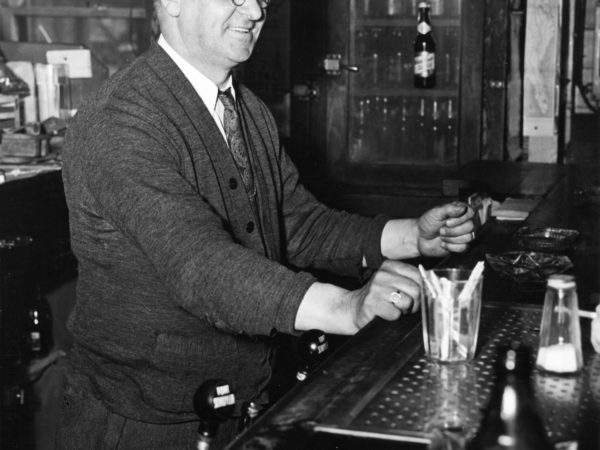 Frank Teich tending bar at the Trading Post in Eagle Bay