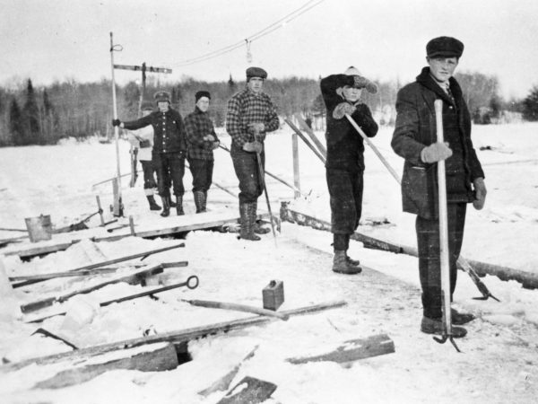 A row of ice harvesters on the Old Forge Pond