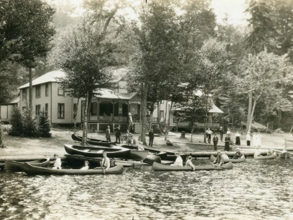 Canoeing outside the Mountain View Hotel and Cottages on Fourth Lake in the Town of Webb