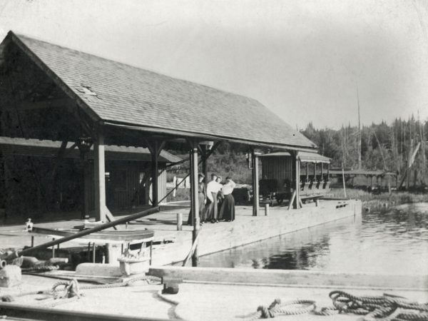 Forge House waitresses pose on the navigation dock on the Old Forge Pond