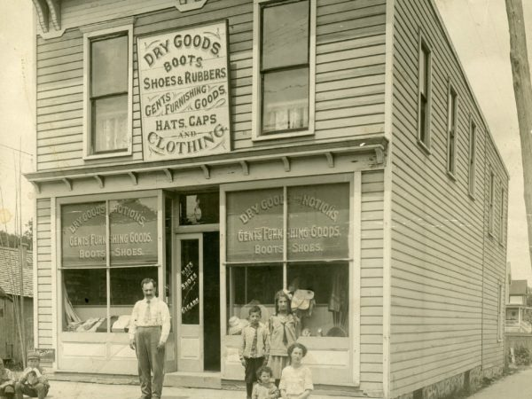 Berkowitz family outside their dry goods store in Old Forge