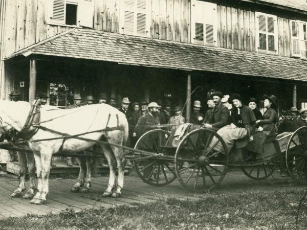 Buckboard spring wagon in front of the Forge House in Old Forge