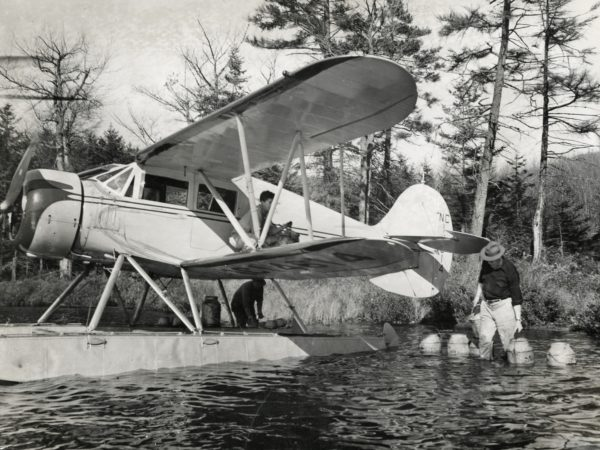 Fish stocking on Crooked Lake in the Town of Webb