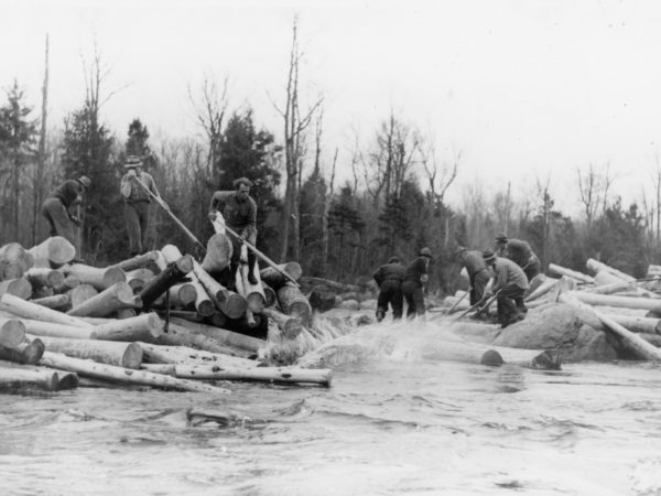 Breaking a log jam during spring drive in the Town of Webb