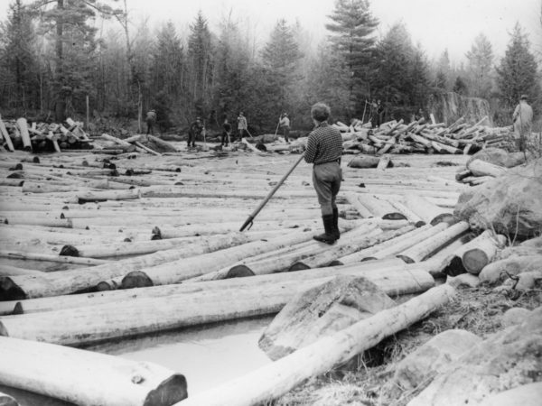 Eight loggers breaking log jam in Town of