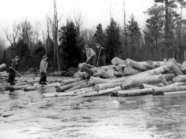 Five loggers breaking log jam in Town of Webb