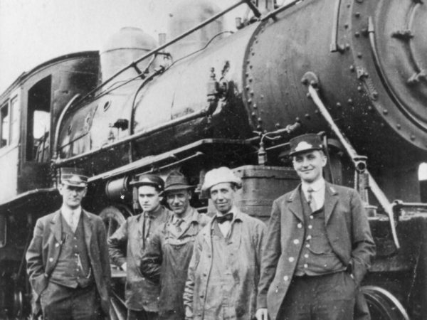 Railroad engine and crew in the Town of Webb