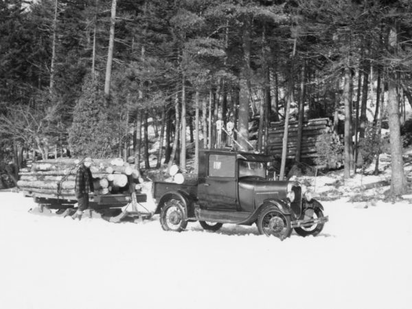 Hauling logs with Model A Ford truck in the Town of Webb