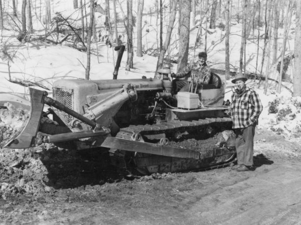 Moving snow with a D6 Bulldozer for Clarence J. Strife's logging operation in the Town of Webb