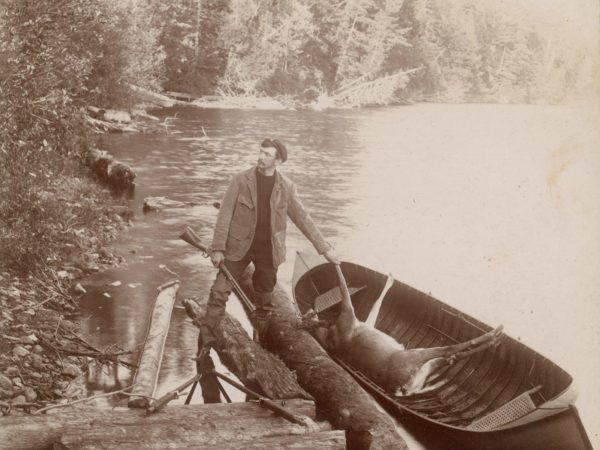 An Adirondack guide and his guide boat at Twitchell Lake in the Town of Webb