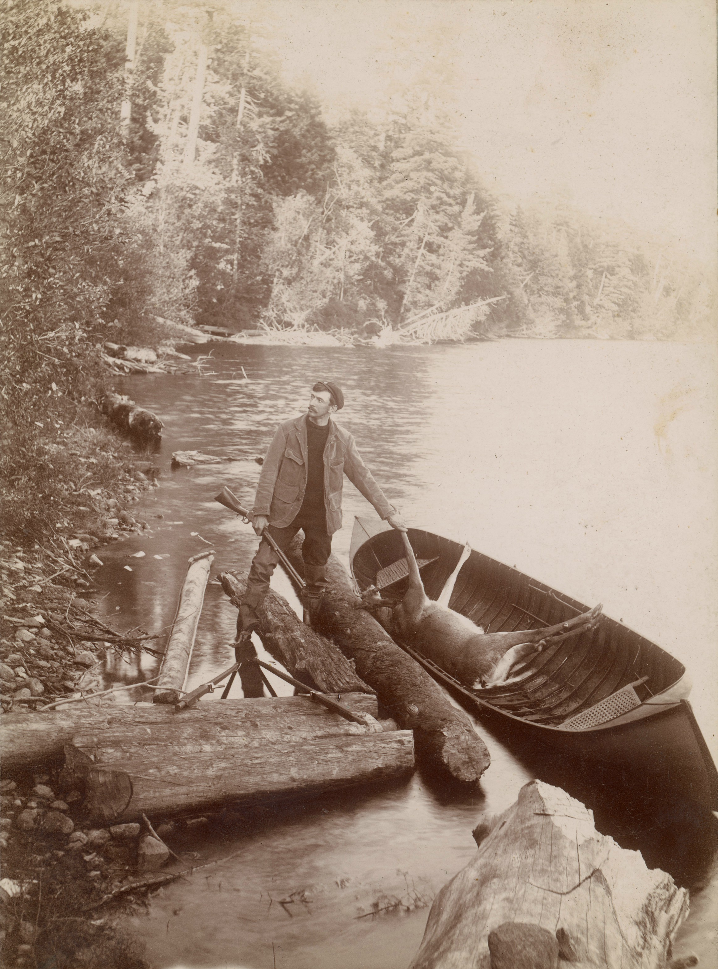 An Adirondack guide and his guide boat at Twitchell Lake ...