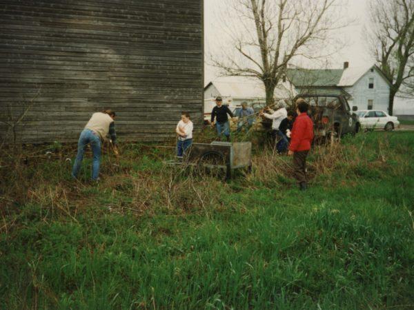 Community members work to restore the old meeting house in East De Kalb