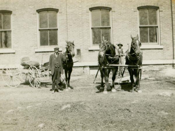 Two men and their horses in De Kalb Junction