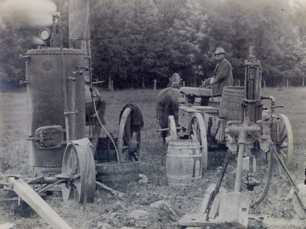 Road crew operating a steam drill in the Town of De Kalb