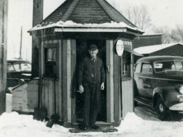 A flagmen in front of his office in De Kalb Junction