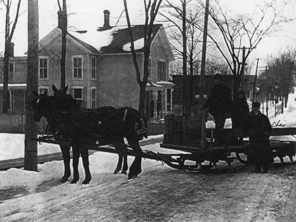 Delivering wood with a bobsled in De Kalb Junction