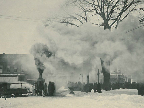 Firefighters battle the Spaulding fire using steam pumper in Canton