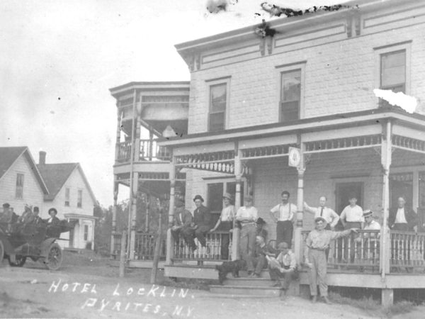 People on the porch of Hotel Locklin in Pyrites