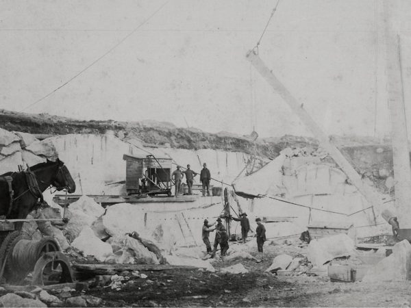 Men working with a steam drill in the Canton Marble Quarries