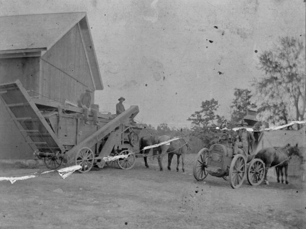 Threshing crew and harvest machinery in Canton