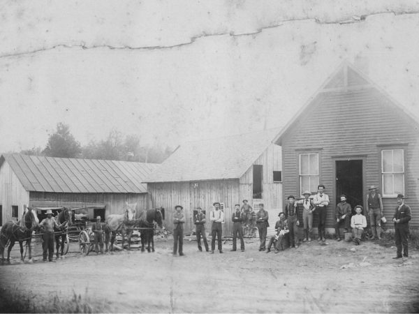 Workers outside sawmill on the Little River in Fine
