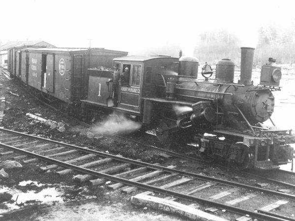 Lumber company workers on steam locomotive in Newton Falls