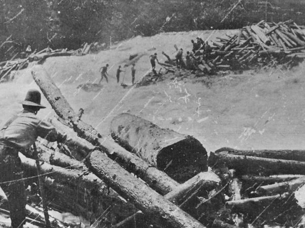 Loggers during a spring log drive on the Racquette River in Colton