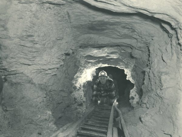 Miners climbing ladder out of talc mine in Talcville