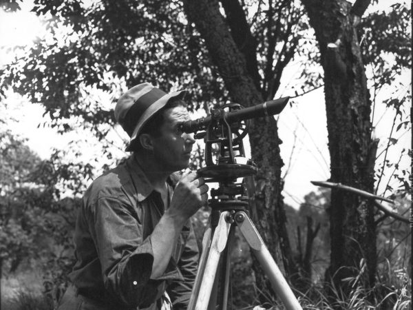 Surveying land with a theodolite in DeGrasse