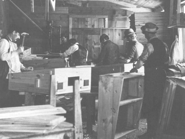 Men at work inside Van Dwyer Furniture Works in Gouverneur