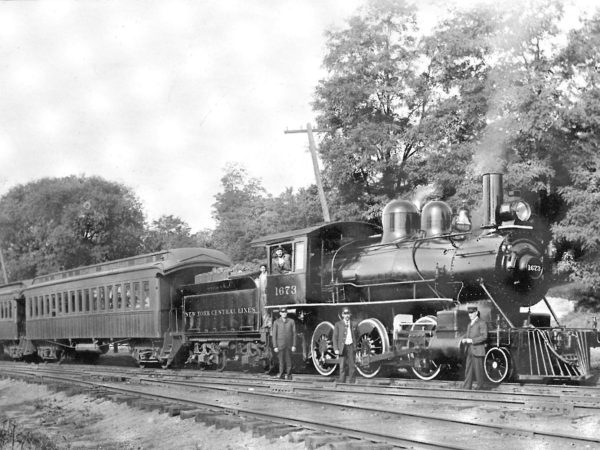 Railroad employees with #1673 Oswegatchie Railroad locomotive in Gouverneur