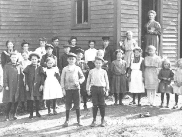 Students and teacher outside the Oswegatchie Union School in Star Lake