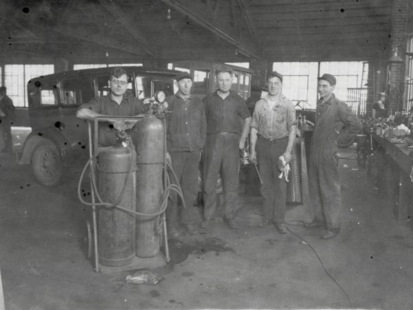Employees in the Spooner Campbell Company Garage in Gouverneur