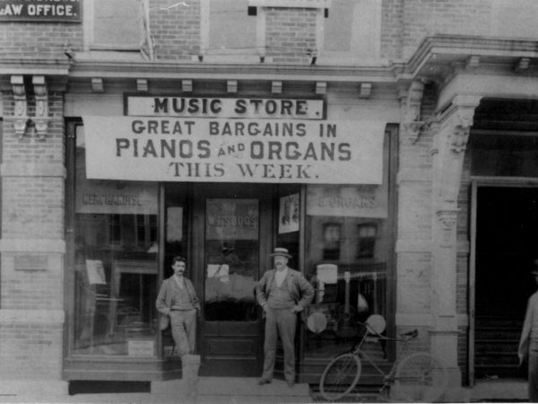 Professor Sudds in front of his music store in downtown Gouverneur