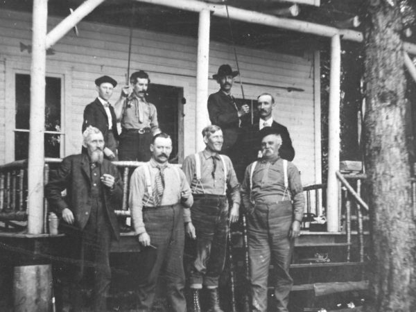 Adirondack hunting guides in front of Howland's Camp in the Adirondacks