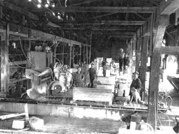 Workers cutting marble in Gouverneur