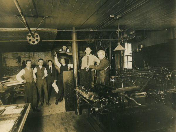 Employees in the office of the Commercial Advertiser in Canton